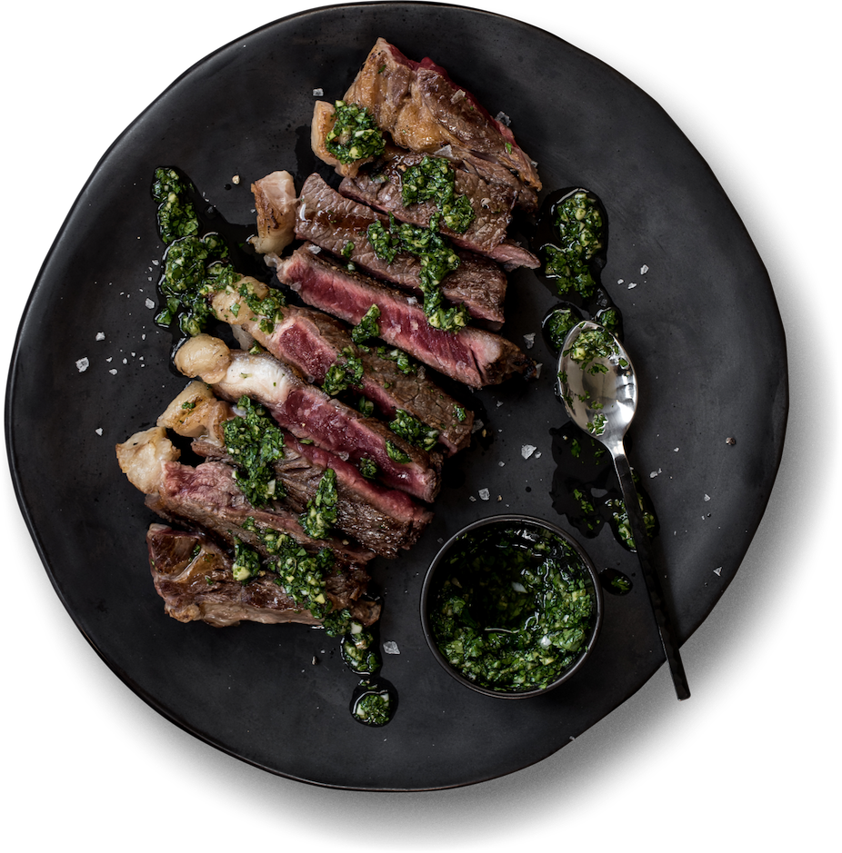 Plate of steak with chimichurri sauce